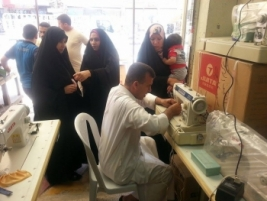 Advice Centre in Najaf, distributes 4 sewing machines as part of the charity bank program supporting small businesses 04/06/2014