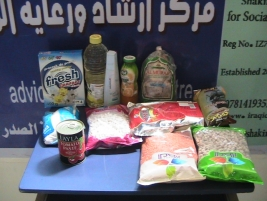 Sadr City Advice Centre distributes meat, food baskets and clothing for the benefit of needy families.