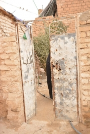 A widow with three children appeals for help to provide better living conditions for her family